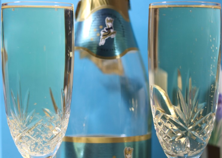 two glasses of Babycham with the bottle and logo blurred in background