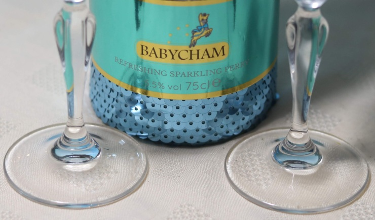 Label of Babycham and stems of two glasses