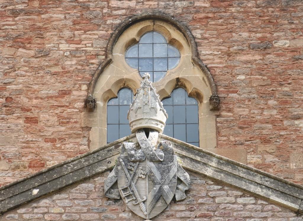 Bishop of Bath and Wells' mitre in stonework over the doorway to the Bishop's Palace, Wells